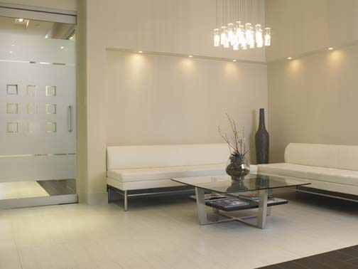 Frosted glass door, statement lighting, mostly white with bolder color pieces