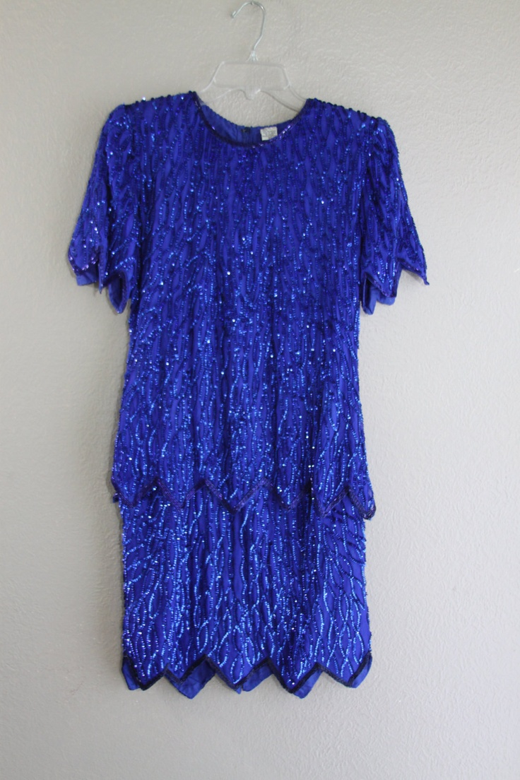 cobalt blue beaded wiggle dress with zig zag tiered hem- amazing vintage- small. $115.00, via Etsy.