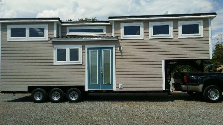 """Voted """"Best in Show"""" at the 2016 Tiny House Jamboree, this gooseneck tiny house offers a different design than the traditional loft bedroom with ladder."""