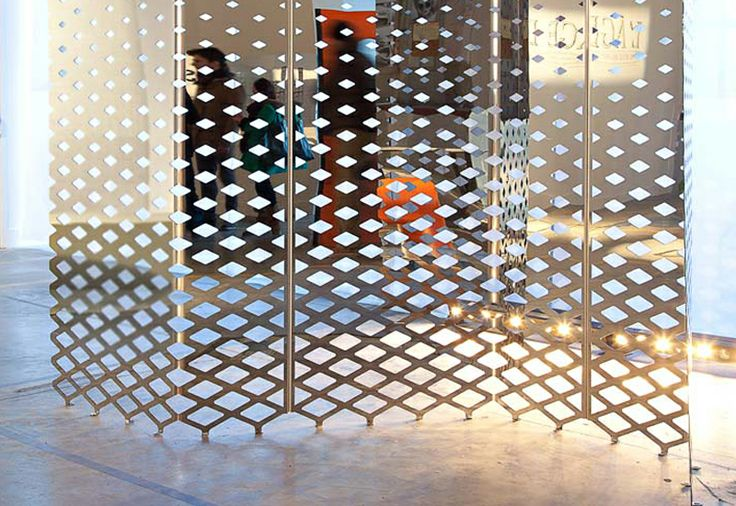 "Screen Mirror | Normal Studio for la Tôlerie Forézienne | Polished stainless steel | ""From a polished stainless steel perforated sheet, we created a mirror to reflect the size of the city. By breaking the reflection it creates the illusion to play with reality. A progressive perforated frame suggests what lies on the other-side."""