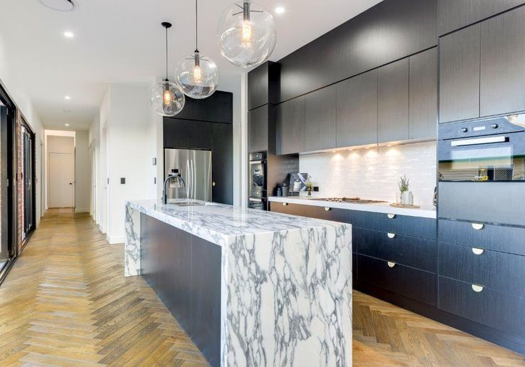 Marble Waterfall Bench Top, Dark Cupoards - Kitchens Brisbane