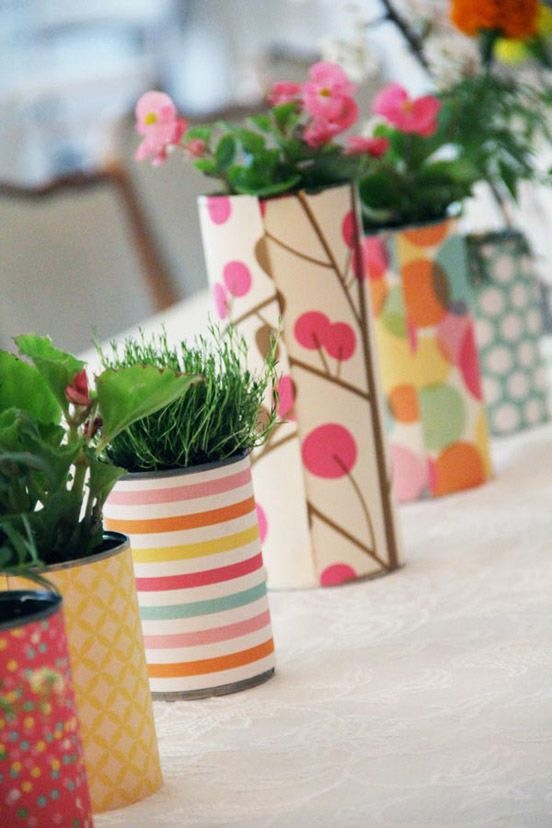 Flowers in tins covered with wallpaper/wrapping paper