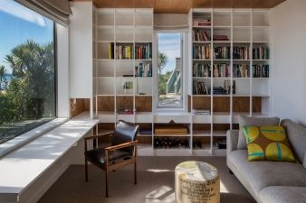 The study/library shares the same spectacular beach views