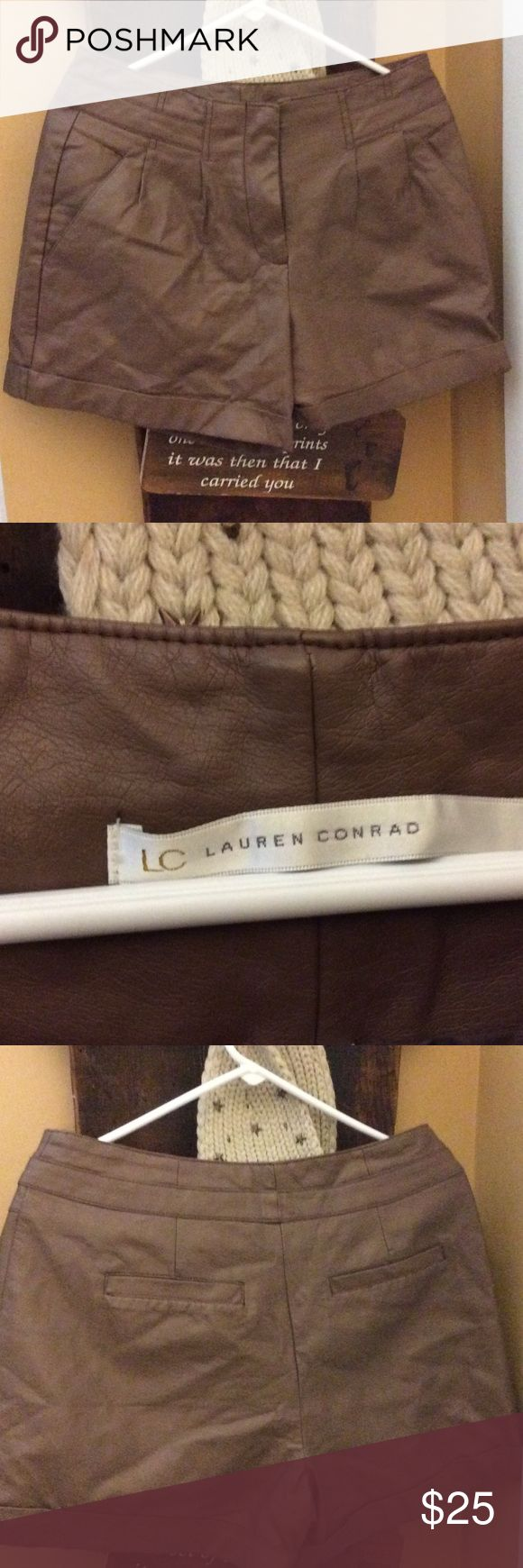 Lauren Conrad leather look shorts Cute Lauren Conrad leather look shorts Zips in  front Pockets in front and back Cuffed hem  New without tags coating is polyurethane face fabric 100% rayon lining 100% polyester Lined inside LC Lauren Conrad Shorts