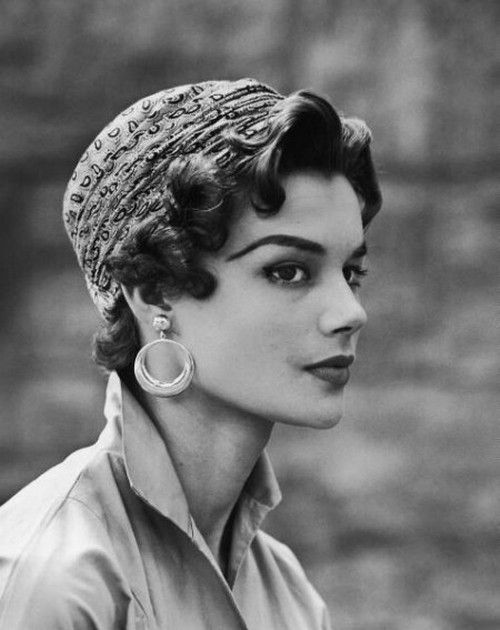 the nifty fifties | Model wearing the new short, curled hair style fashion with a paisley turban | June 1953.