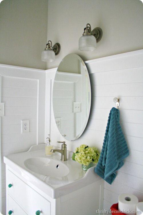 two lights over bathroom mirror