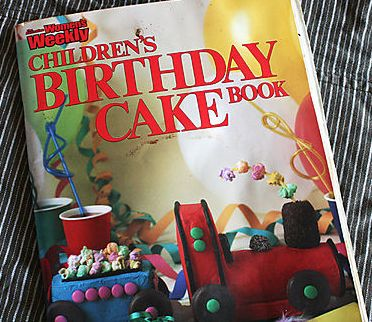 If you are a child of the eighties or nineties, then chances are you spent hours pouring through and trying decide which cake you wanted from your parent's well loved copy of the Australian Women's Weekly Children's Birthday Cake Book. #birthdaycake #birthday #aww #lpl