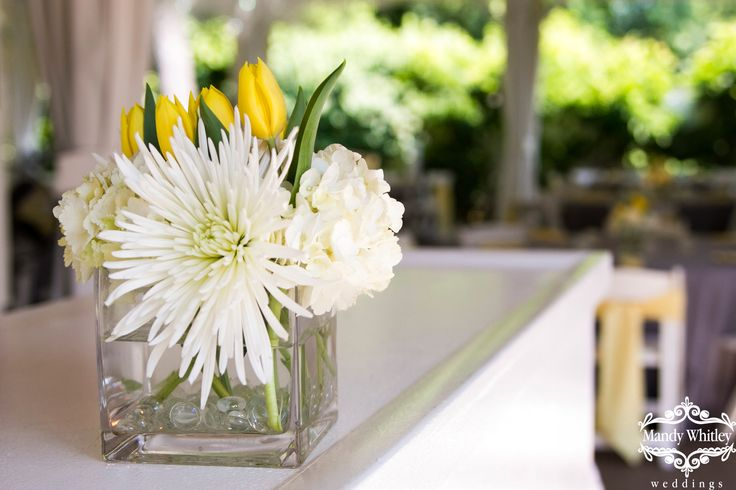 White spider mums and yellow tulips wedding centerpiece