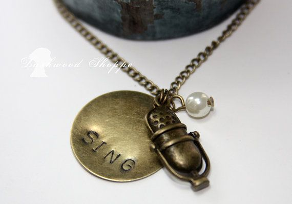 Hey, I found this really awesome Etsy listing at https://www.etsy.com/listing/98470218/vintage-microphone-sing-music-necklace