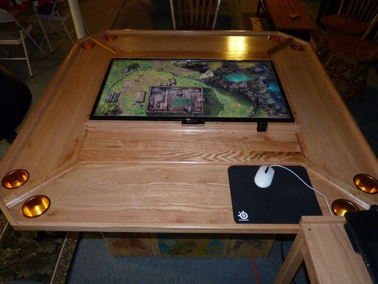 I love this idea! Virtual tabletop at the tabletop! DM can present maps and multimedia material to the group. Miniatures can be played directly on the screen. I just need a man cave to put it in!