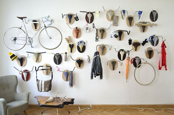 """Hunting Trophies is a project by designer Andreas Scheiger that he describes as """"Upcycle Fetish"""". The reference is clearly to Pablo Picasso's """"head of a bull"""", a ready-made piece from 1942 well known in the field of contemporary art. Andreas integrates parts of used bicycles (saddles, handlebars and brake levers) with oval wood plates, recreating hunting trophies plus adding useful hangers to a wall."""