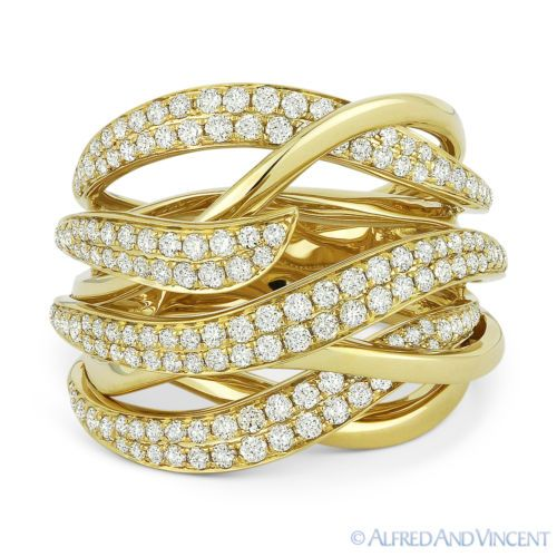 The featured ring showcases a fancy design made up of overlapping 14k yellow gold swirls and arches pave-set with round brilliant cut diamonds.
