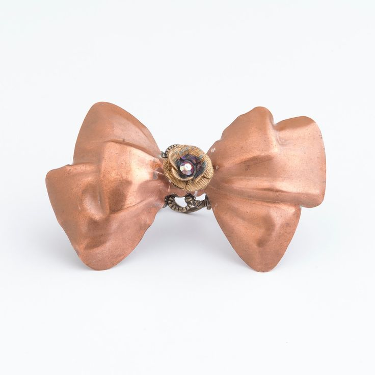 Let those Maximalist feelings out with our gorgeous super sized Bow Dangle Ring. Vintage Copper Bow mounted on an adjustable filigree ring with a precious crystal centred flower strategically centred for maximum maximalist impact!!!