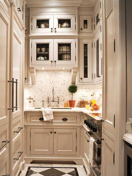 A 6x16-Foot Galley Kitchen: The Custom Tricks That Make It Work Small Kitchen Inspiration  I'm looking at farmhouse ceramic sink, dark gray counters, white cabinets, some with glass door, a good lazy susan and organized cutlery drawer