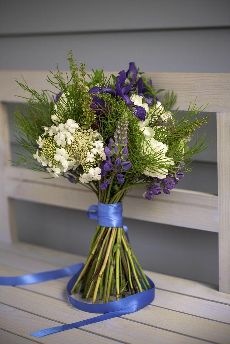 Wild  flowers / purple lupins / arrowwood flowers / bouquet / early summer bouquet
