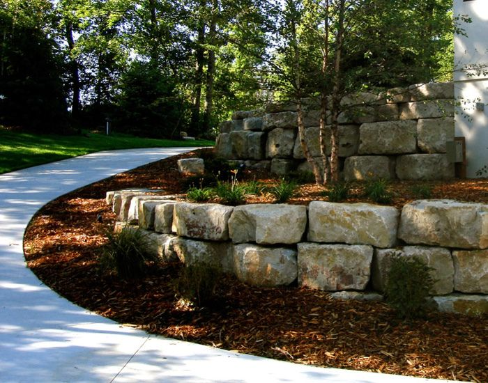 at boulder images we design boulder retaining walls that fit into the natural landscape of your - Landscape Design Retaining Wall Ideas