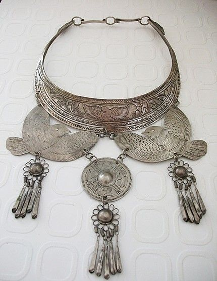 Tribal tooled metal statement necklace...perfect for a music festival, reminds me of free people..boho chic