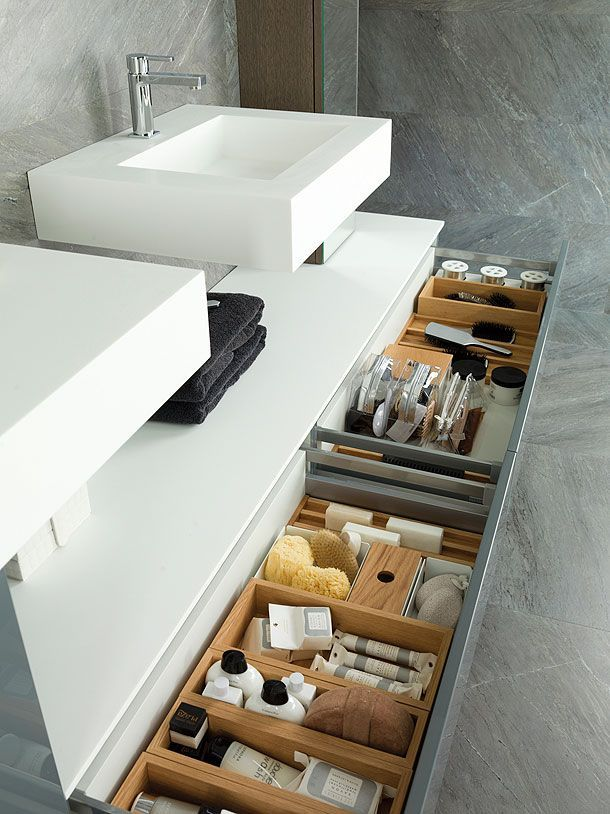Organized bins under the bathroom sink.