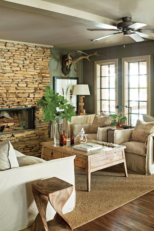 """Richard sometimes adds black to deeper paint colors to make the hues more intense.  Richard's Style Tip: """"Fill a lake house with comfy pieces so you can't wait to sit down.""""  Get the Look!  Swivel Chair (1011-01SW), from $1,521"""