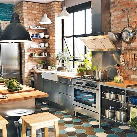 Kitchen with tiled floor, brick walls and wooden and stainless steel units