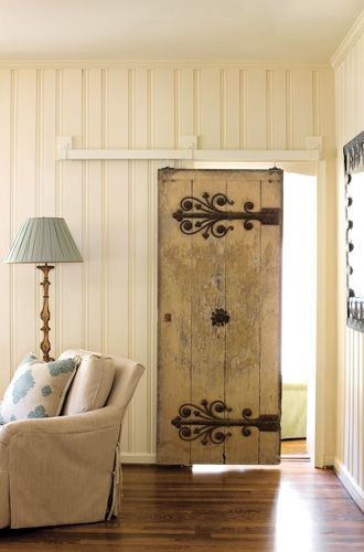 "I really need a door like this. -- ON TRACK ""This door was a fabulous Angie Tyner [A. Tyner Antiques] find that is very old. It's in its original state—not even the iron on it has been touched up. But it weighs a ton! So we built a track above it that allows it to easily slide back and forth like a barn door."""
