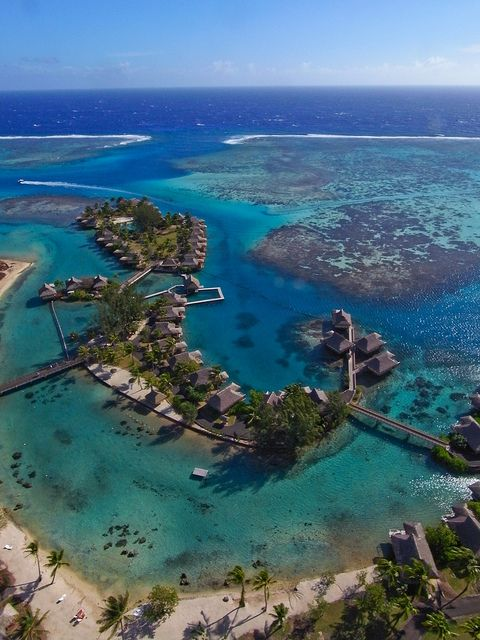 InterContinental Resort in Moorea Island, French Polynesia (by Pierre Lesage).  Looks like nice fishing right off that sandbar, too.