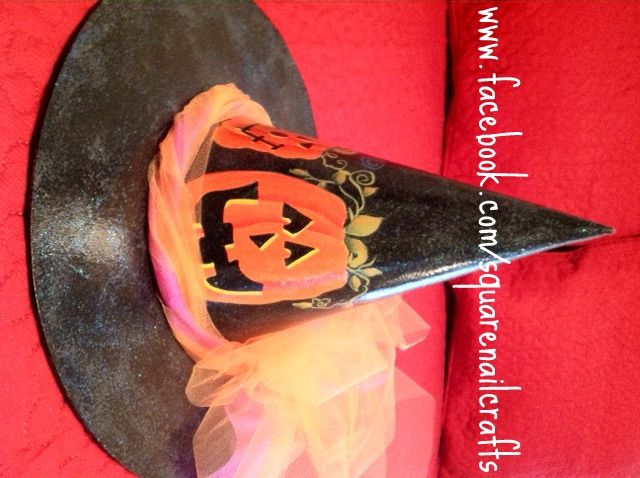 One side of my witch hat that I painted using a Laurie Speltz design.