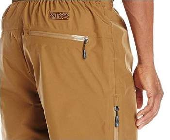The water resistant back pocket serves as the stuff sack. The side zipper is also visible.
