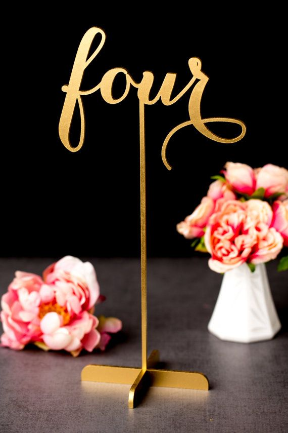 Love these gold table numbers in that gorgeous script! Perfect ...