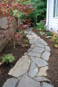 Love the curved stone walkway surrounded by mulch, small trees, shrubs, hostas