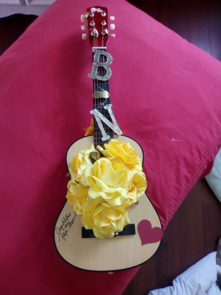 Upcycle small guitar into creative signature book for musician inspired wedding. Marquee lights turn on to light up letters of bride and groom. Used bride's  favorite colours. Everyone loved it. Can't wait to make another one.
