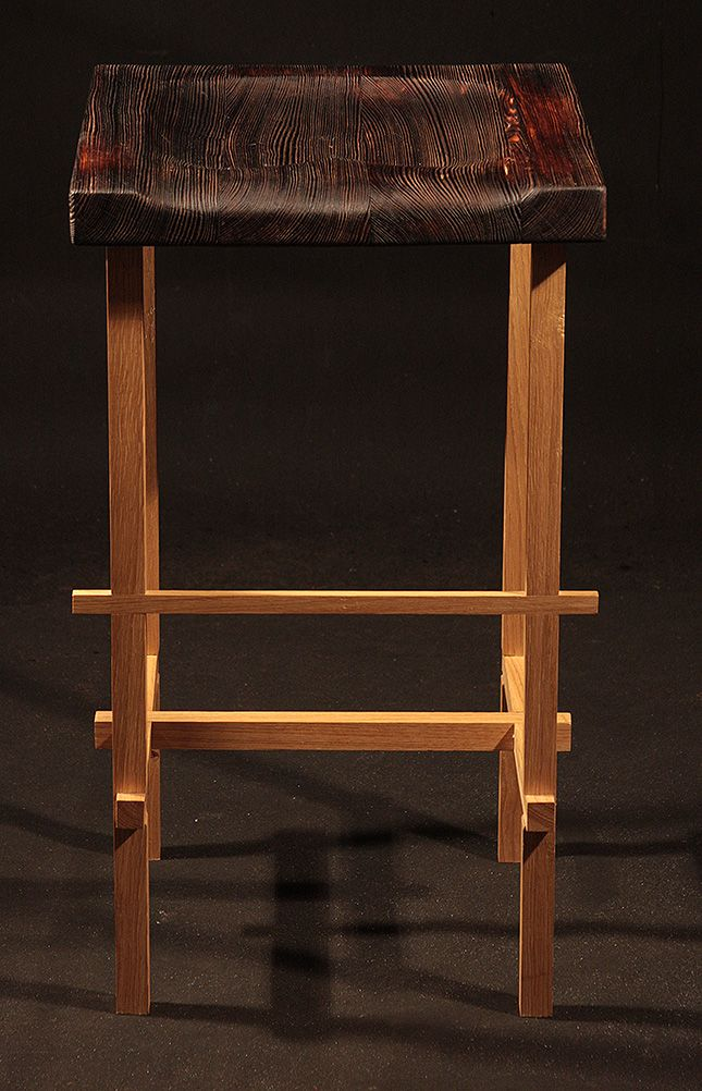 A chair made from oak and pine. Construction based on the traditional Japanese carpentry connections. Hand-profiled seat, finished in technique shou sugi ban, covered with natural oil www.drewnoikamien.pl