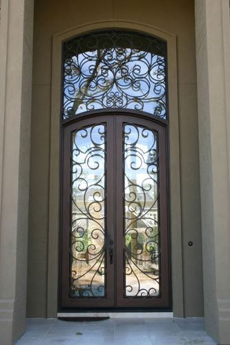 Wrought iron door with transom.