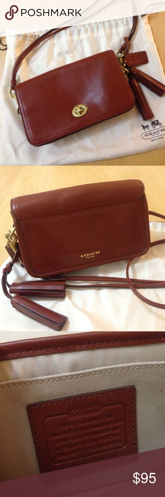 "Coach legacy penny mini crossbody purse Coach legacy penny mini crossbody purse in cognac. Gold hardware. 7.75""l, 5""h, 2.25""w. Never worn, like new. Comes with dust bag. A classic--goes with every outfit! Coach Bags Crossbody Bags"