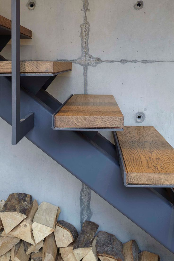 These wood and steel stairs seen in a renovated home, used upcycled timber from the original space for the stair treads, and the wood and steel keeps with the industrial look of the home.