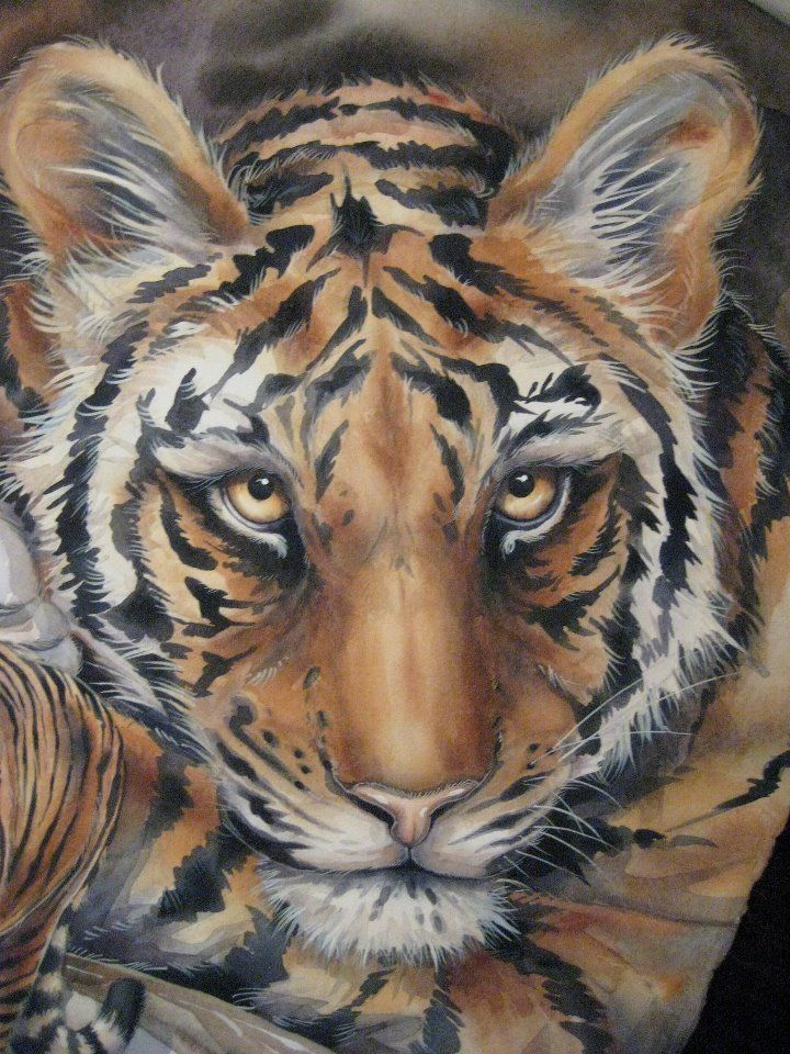 Jody Bergsma. She finished his painting on the day he died. http://www.bergsma.tv/tiger-tiger-burning-bright%E2%80%A6the-famous-woodland-park-zoo-lost-its-tiger-rakata-today%E2%80%A6a-tribute-and-how-to-paint-a-tiger/701/