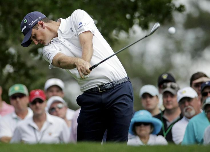 Justin Rose, of England, tees off on the fourth hole during the fourth round of the Masters golf tournament Sunday, April 13, 2014, in Augus... #PlayABetterGolfGame