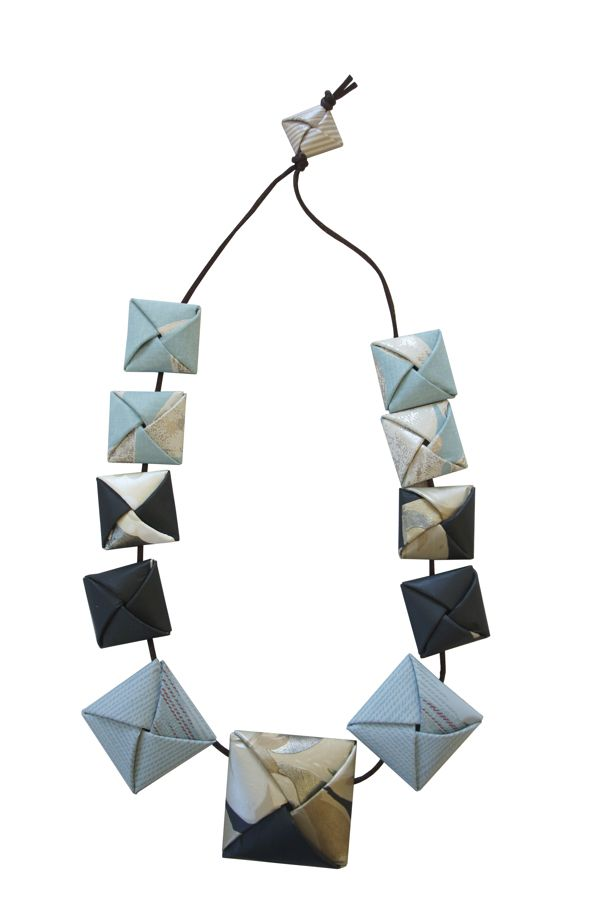 Paper and Rubber  necklaces and earrings by Corinne Luppi, via Behance