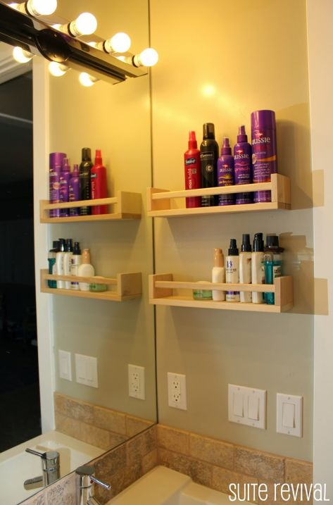 Ikea spice rack. $3.99 each for all my many hair products.