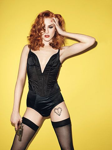 Evan Rachel Wood. Black Corset. GQ. Red Hair. Gun. Poppy light.