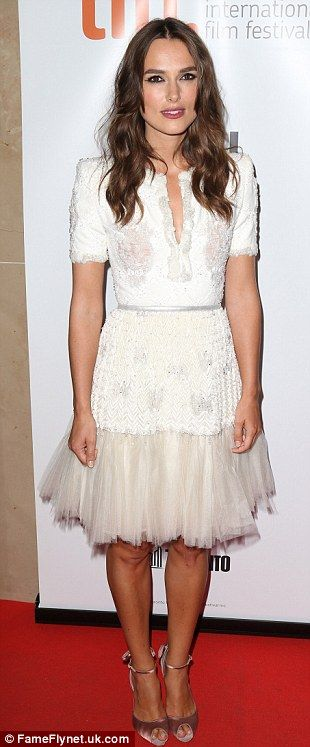 Frill seeker: The 29-year-old sported an elegant white lacy dress to the evening festivities