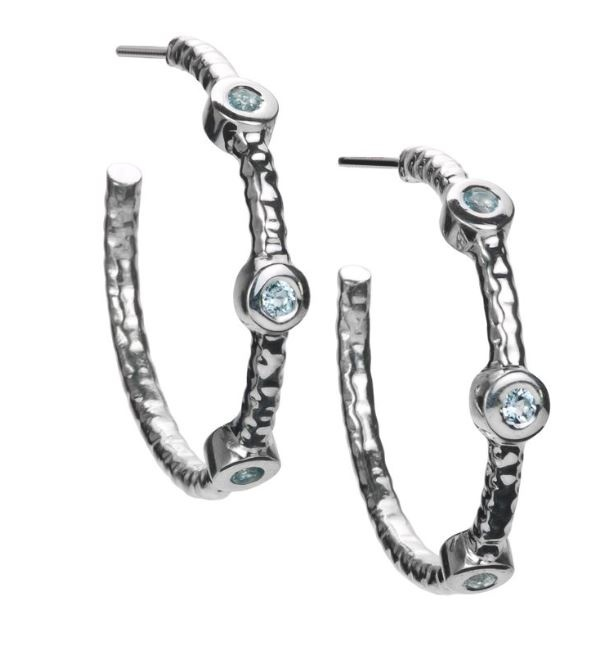 Wilu hoops Sterling Silver from the Kamari collection are hand-hammered hoop earrings with three semi-precious stones. Featured with a Blue Topaz gemstone. #silver jewelry #silver earrings