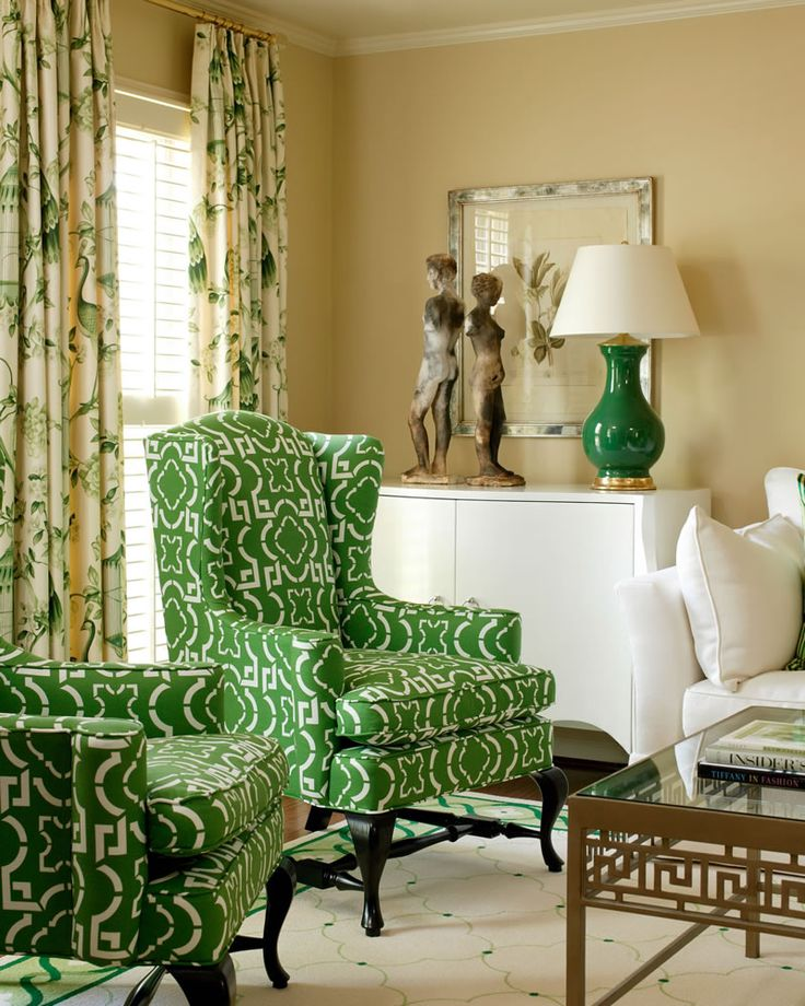 Inverness - Tobi Fairley Interior Design Green & Gold Living Room - drapes over shutters, wingback chairs in green pattern fabric