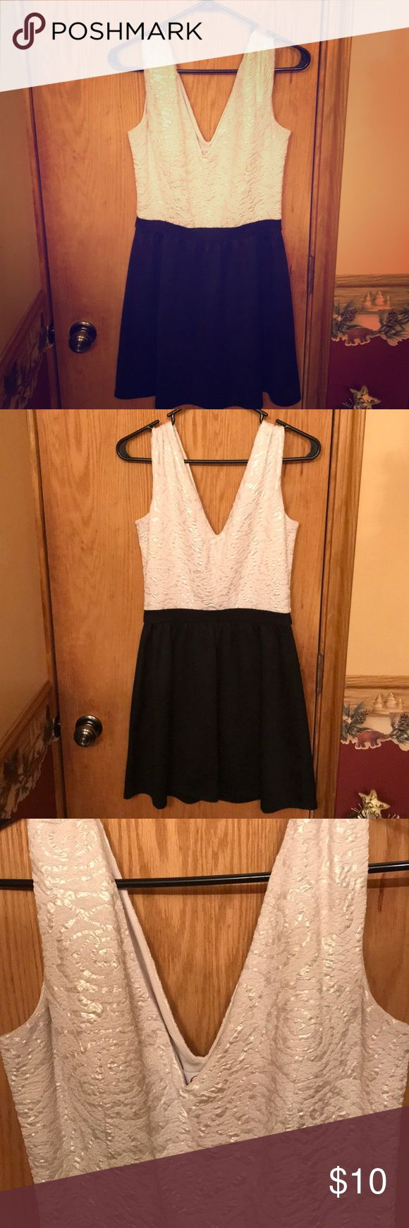 White & black Candie's dress worn once! White & black dress. White part is slightly textured. Size Medium, only worn once for New Year's Eve 2016. Candie's Dresses