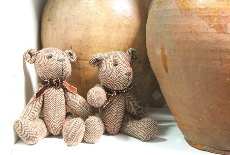 So sweet - these small fabric teddies nestled amongst the pots ....