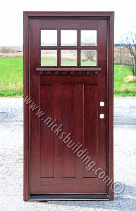 Country Style Front Door In A Red Mahogany Stain Color