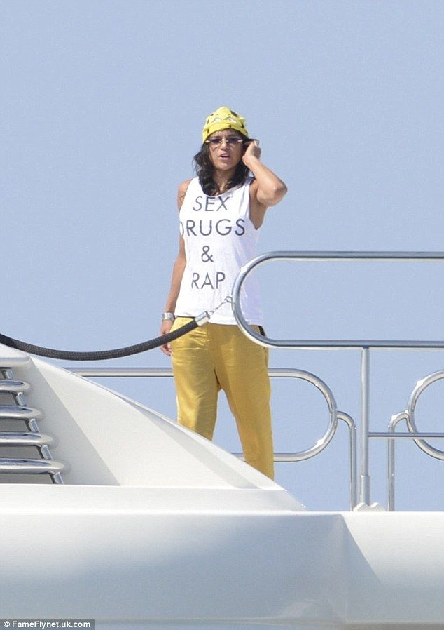 Her motto? Zac Efron's girlfriend Michelle Rodriguez raised a few eyebrows with her choice of attire on Sunday