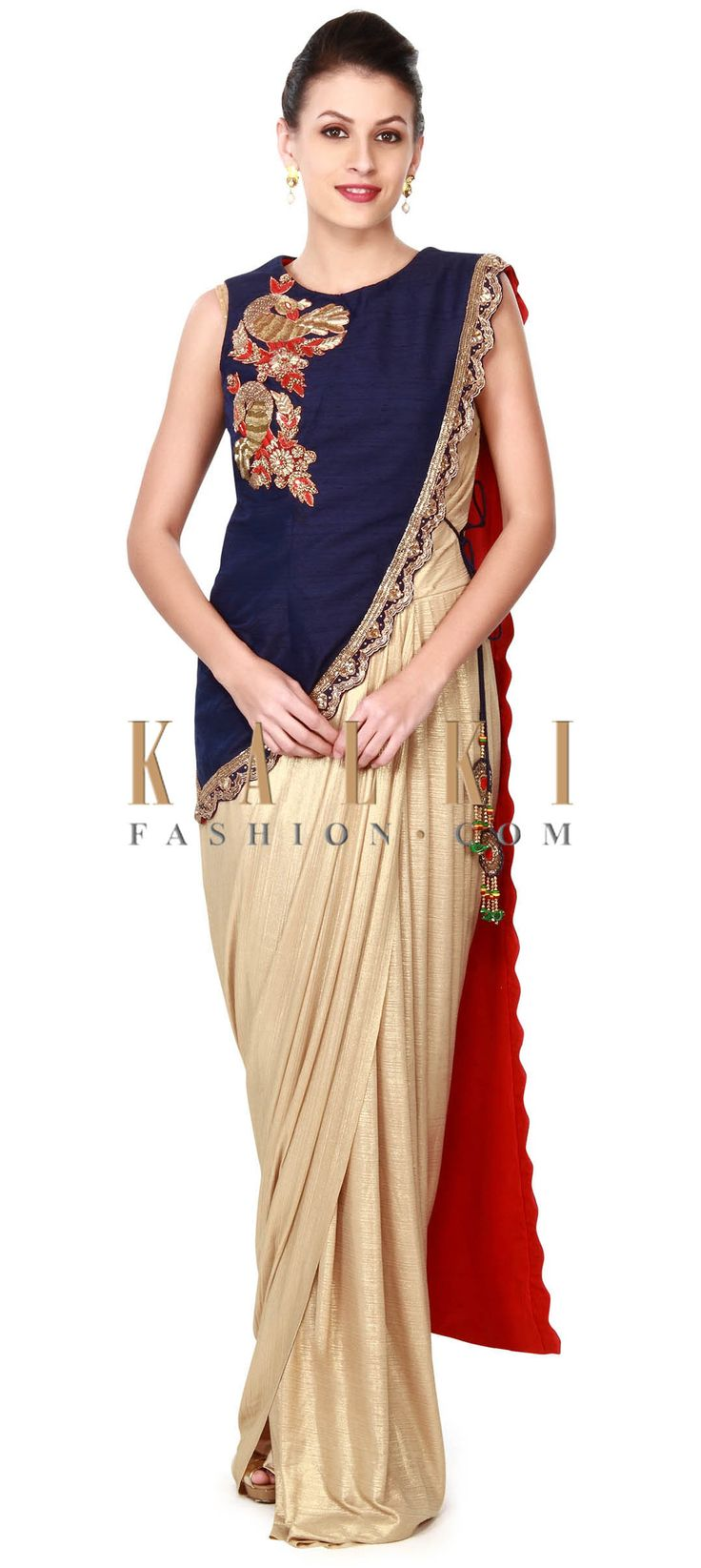 Buy this Gold lehenga with navy blue long blouse only on Kalki
