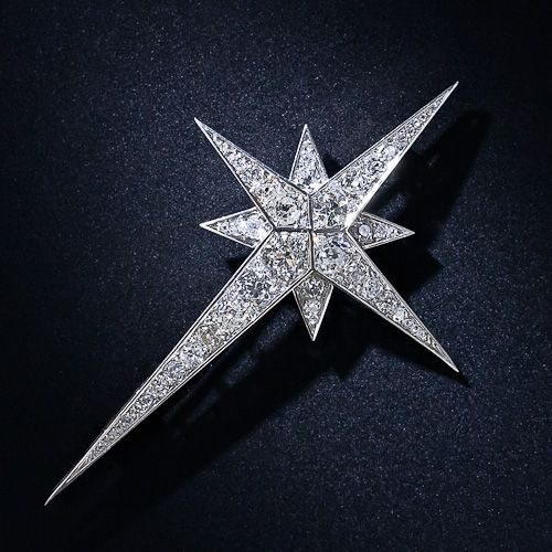 North Star brooch, crafted in platinum, early-Art Deco period - circa 1920, and measures 2 7/8 inches by 1 3/4 inches