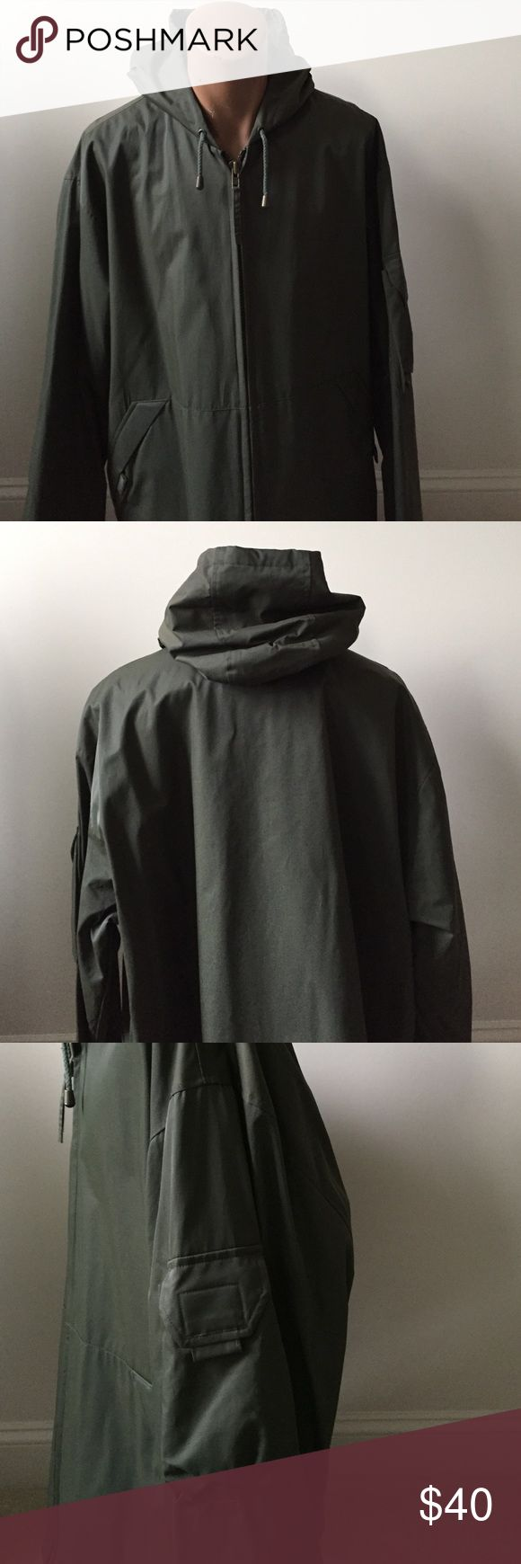Marc New York men's raincoat. Olive lined military nylon raincoat. Front pockets and one side pocket. Zips up front with drawstring for hood and at waist. New with tags. Marc New York Jackets & Coats Raincoats